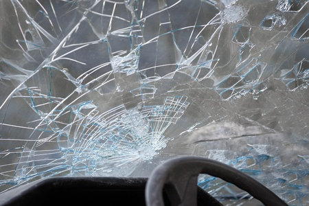 smash: Smashed windshield seen from inside the vehicle