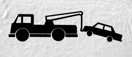 tow: Sign wth car being towed away by a truck Stock Photo