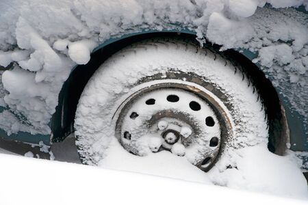 drifting ice: Wheel of car in heavy snow