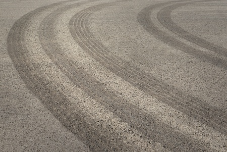 background with tire tracks on asphalt Stock Photo - 11083839