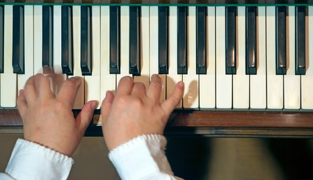 Close up of hands of a pianist photo