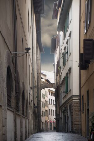 firenze: Narrow street in Florence, Italy, on a cloudy rainy day Editorial
