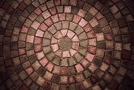 empedrado: Empedrado de la vendimia con forma circular �tiles para el fondo Foto de archivo
