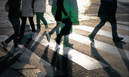 Silhouettes of people at pedestrian crossing photo