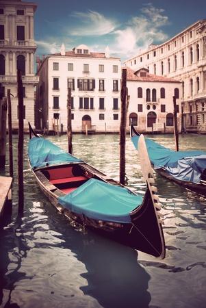Moored traditional blue gondola in Venice, Italy photo