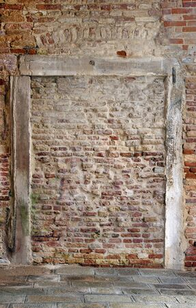 Brick wall with frame of old weathered wood Stock Photo - 11888479