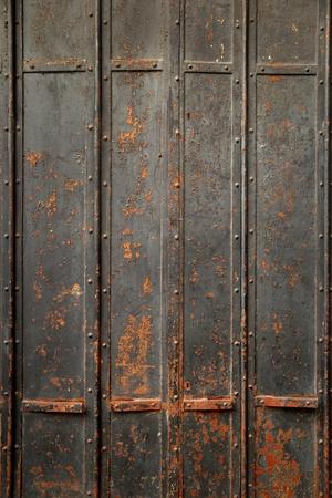 Rusty Metal Door background of ancient black rusty metal door stock photo, picture