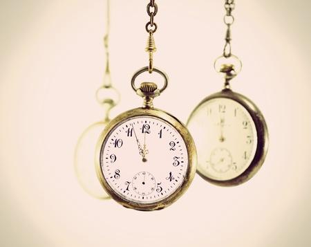 Three vintage pocket watches isolated on white Stock Photo - 11888462