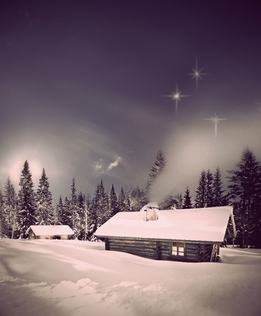 log cabin in snow: Remote log cabin in winter evening with stars in sky