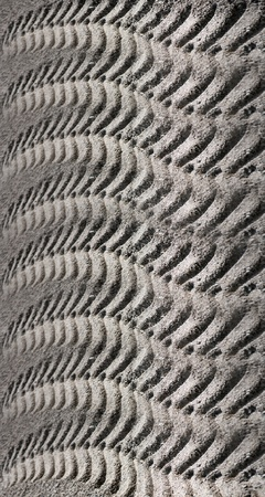 Abstract design from tire print of heavy vehicle in sand photo