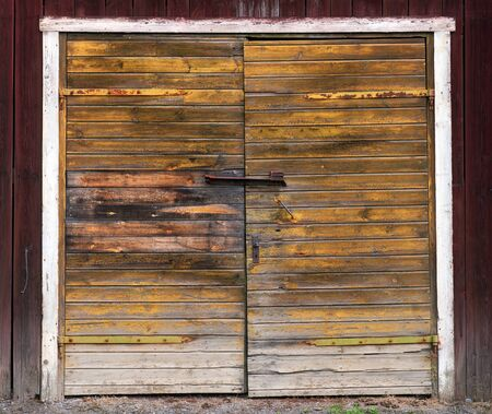 closed door: Old weathered double wooden door on shed