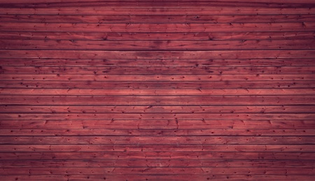 Background of old red knotted wooden wall