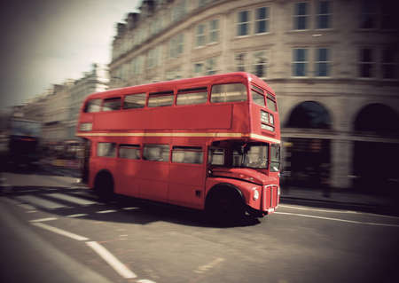 Vintage red double decker bus in London photo