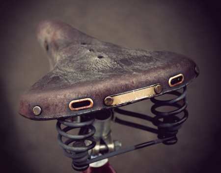 vintage leather bike saddle with metal spring  Stock Photo - 12075068