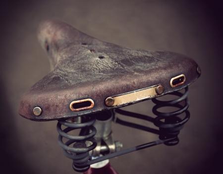 metal spring: vintage leather bike saddle with metal spring