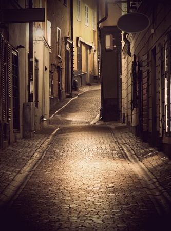 cobblestone street: Narrow street in the old town of Stockholm at night