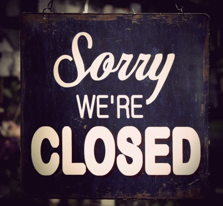 closed door: Vintage metal closed sign on shop door Stock Photo