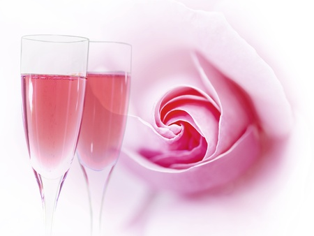 pink bubbles: Two flues of pink champagne with pink rose in background Stock Photo