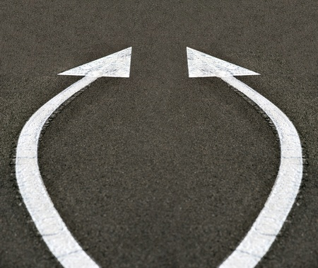 White arrows on asphalt representing  future, forward, focus, possibilities photo