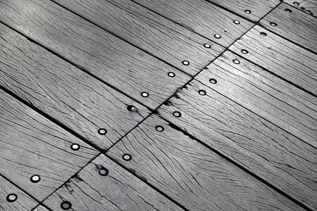 baclground: Background of bridge with weathered wooden floor fastened with bolts