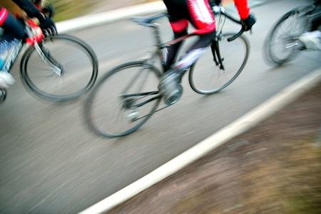 road cycling: High angle view of racing bicycles in blurred motion