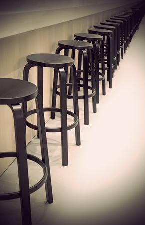 barstool: Row of empty bar stools with vintage look Stock Photo
