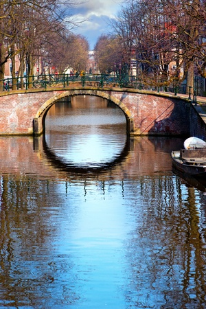 Bridge with bicycles over canal in Amsterdam Stock Photo - 13100952