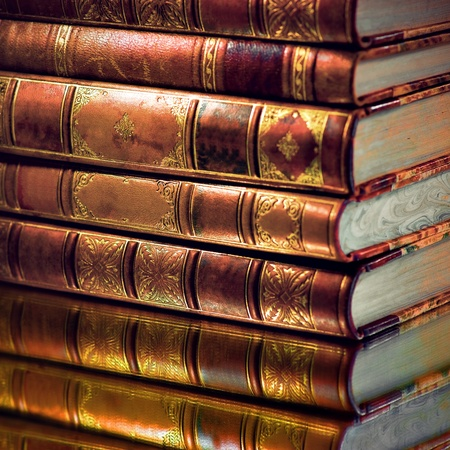 Heap of vintage books with golden touch photo