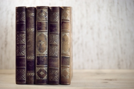 literatures: Row of leather vintage books on shelf Stock Photo