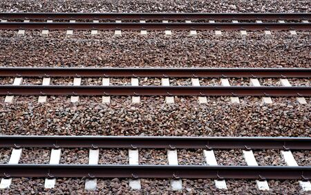 wood railroad: Three parallel railway tracks on pebbles Stock Photo