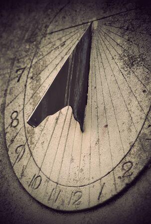 岩の上の古代の日時計のクローズ アップ 写真素材