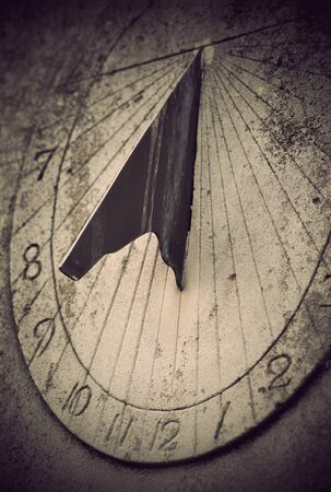 Close up of ancient sundial on rock