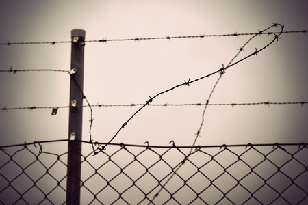 chain link fence: Rusty barbed wire and chain link fence with vintage look