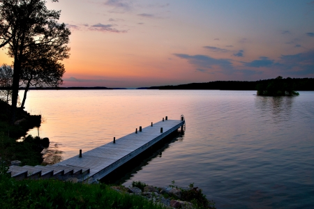 Wooden jetty at sunset in shades of purple Stock Photo - 13797192