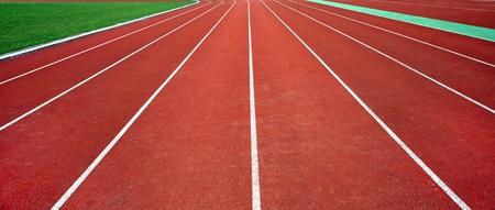 Red straight running tracks in sport stadium photo