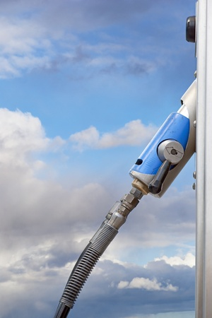 handle on pump for natural gas at service station photo