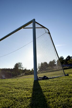 back lit soccer goal in rural area photo