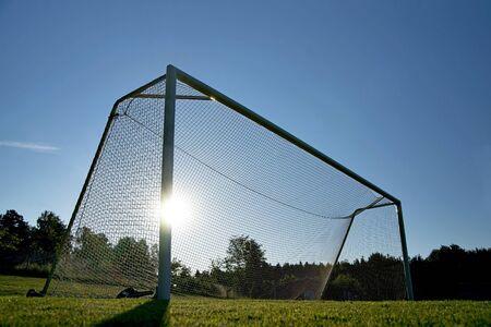 back lit: back lit soccer goal in rural area Stock Photo