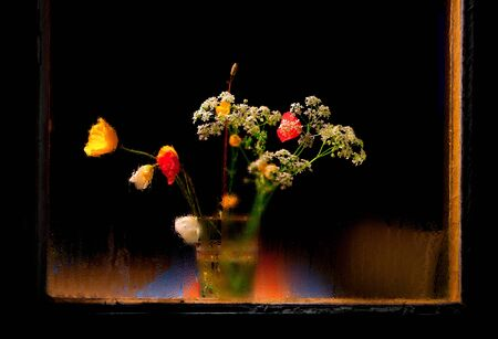 damp: simple vase with wild flowers behind damp window at night Stock Photo
