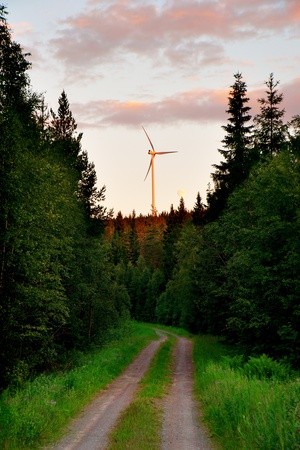 wind turbine on top of mountain in forest area photo