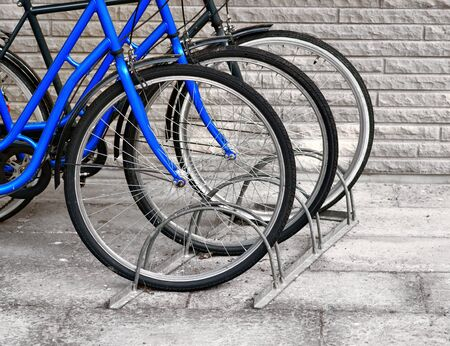 parked bicycles: Front wheels of three bicycles in a row