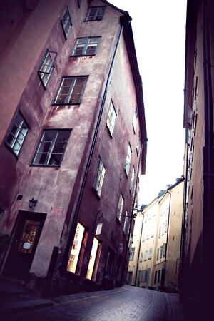 tall buildings: scene from Stockholm old town in vintage style