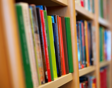 library: Close up of books in wooden book case
