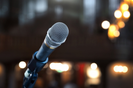 mike: Close up of microphone in concert hall or conference room