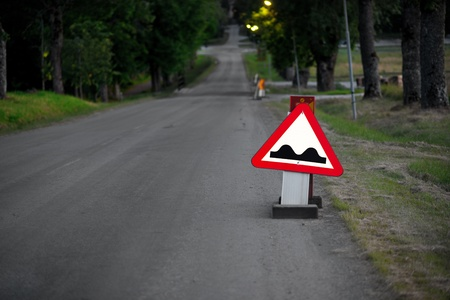 bumpy: Triangular sign warning for bumps in the road