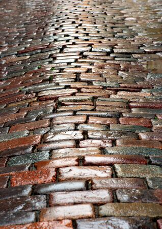 cobble: background of wet cobblestones with puddles