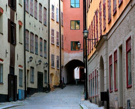 Narrow street with archway in the od town of Stockholm, Sweden photo