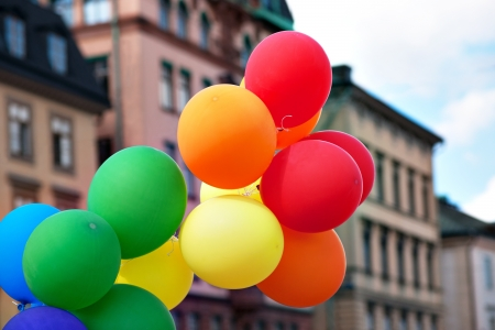 Bunch of balloons in front of urban buildings Stock Photo