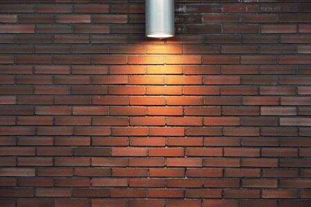 illuminated wall: Background with brick wall Illuminated by electric light Stock Photo