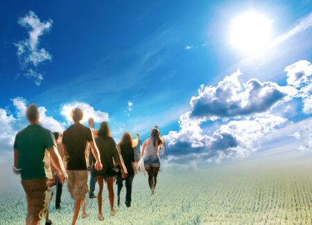 bright future: Bunch of young people walking towards bright but unknown future